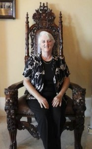 The author sitting on Bill Clinton's chair at Casa Monica Hotel