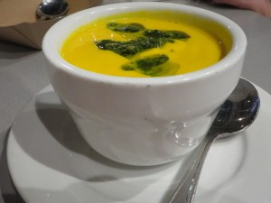 Carrot ginger soup with a dollop of salsa verde.