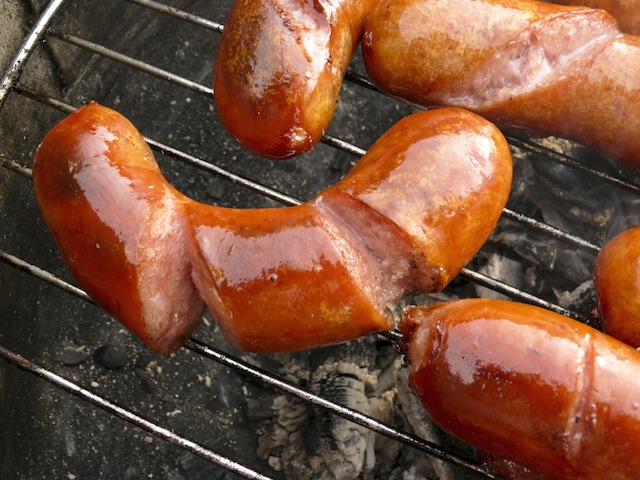 Yummy sausages almost grilled. Bon Appetit!