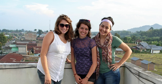 Posing for photos on my homestay's rooftop balcony