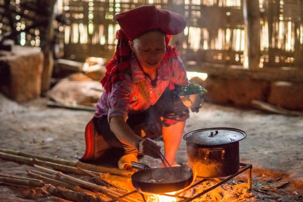 Your host family will cook you dinner over an open fire during your Sapa home stay.  Photo courtesy of Buffalo Tours.