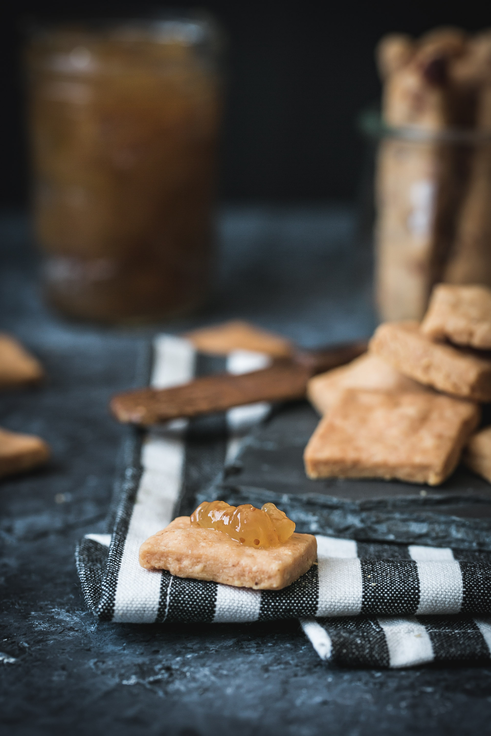 A manchego cheese cracker topped with fig jam