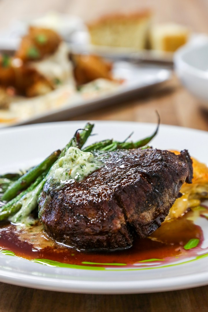A Filet with green beans and a cherry sauce