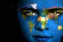 Portrait of a boy with the map of the world painted on his face.