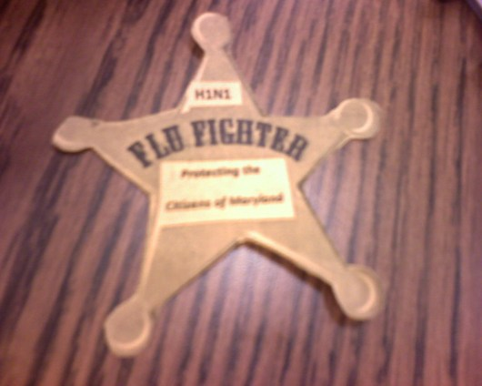 """""""Flu Fighter"""" badges from the public relations office to promote influenza vaccination"""