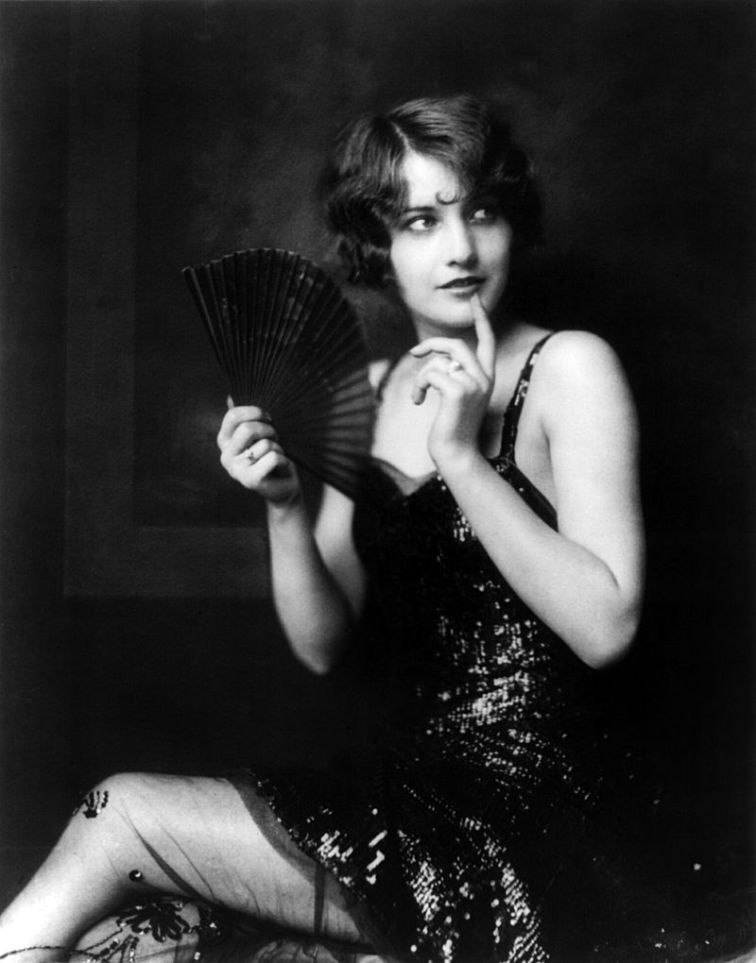 Barbara Stanwyck as a Ziegfeld girl (c. 1924) by Alfred Cheney Johnson (Source: Wikipedia Commons | Library of Congress).