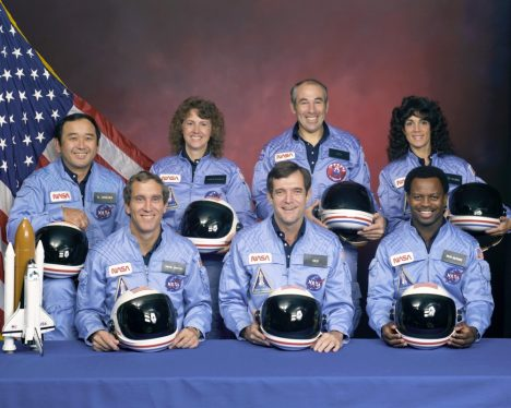 The crew of Space Shuttle mission STS-51-L pose for their official portrait on November 15, 1985. In the back row from left to right: Ellison S. Onizuka, Sharon Christa McAuliffe, Greg Jarvis, and Judy Resnik. In the front row from left to right: Michael J. Smith, Dick Scobee, and Ron McNair. All were killed when Space Shuttle Challenger blew apart 73 seconds after liftoff.