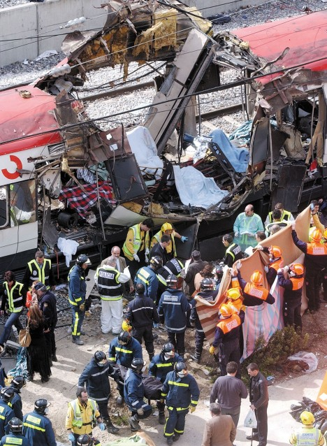 Rescue workers evacuating the bodies of victims of a terrorist train bombing near Atocha Station, Madrid AP