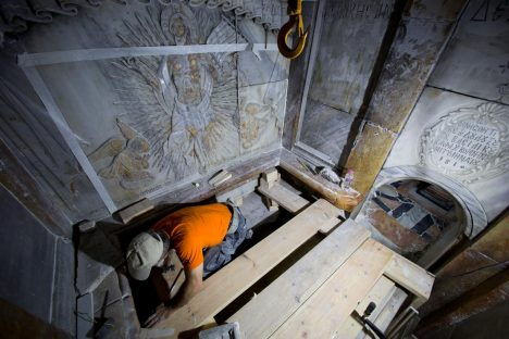 A conservator cleans the surface of the stone slab venerated as the final resting place of Jesus Christ. PHOTOGRAPH BY ODED BALILTY, AP FOR NATIONAL GEOGRAPHIC