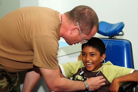 1024px-USS_Kearsarge_medical_team_treat_patients_at_Arima_District_Health_Facility_DVIDS126489
