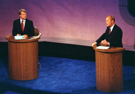 ** FILE ** In this Sept. 23, 1976 file photo, President Gerald Ford speaks as Jimmy Carter listens during the first of three debates, at Philadelphia's Walnut Street Theater. (AP Photo, File)