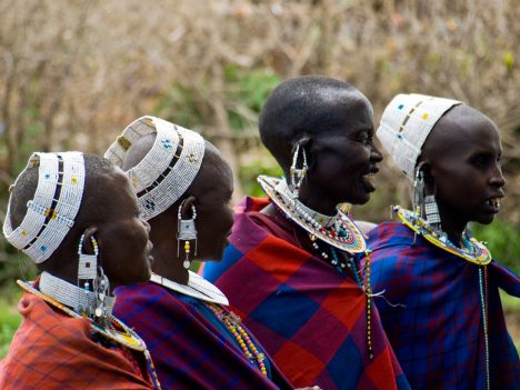 Maasai villagers in traditional clothing and jewellery in the Serengeti National Park, Tanzania