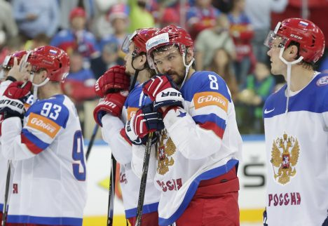 Russia's Alexander Ovechkin, second from right, stands during the medals ceremony after his team was defeated by Canada in the Hockey World Championships gold medal match in Prague, Czech Republic, Sunday, May 17, 2015. (AP Photo/Petr David Josek)