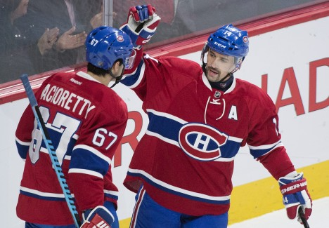 Montreal Canadiens' captain Max Pacioretty (67) celebrates with teammate Tomas Plekanec after scoring on the Ottawa Senators during first period NHL hockey action, in Montreal, on Saturday, Dec. 12, 2015. (Graham Hughes/The Canadian Press via AP)