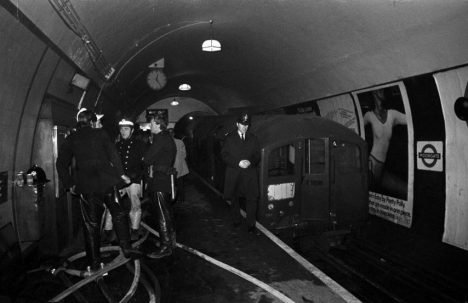 he battered third coach of the disaster train pulled back from the tunnel entrance at Moorgate underground station, while rescuers continue to work on freeing more bodies.