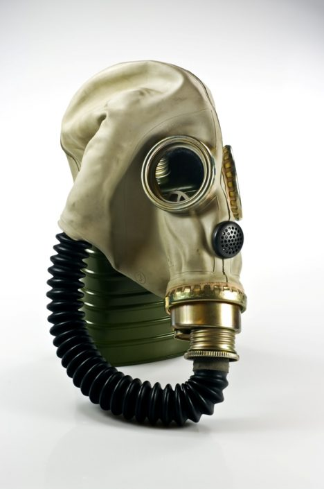 Old military gas mask on white background