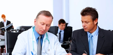 Podiatrist Informing Patient