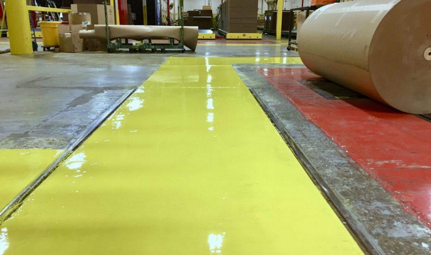 Epoxy flooring yellow safety walkway