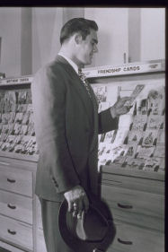 Man looking at greeting cards