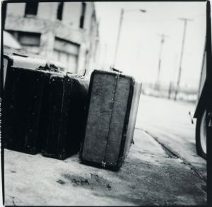 Old suitcases next to a car