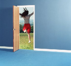 Woman leaping through doorway into field