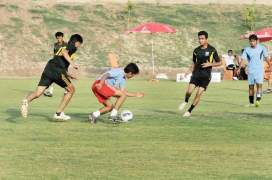 Boys playing football in DHA Lahore Sports Complex