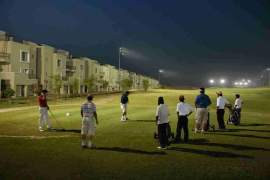 Golfers playing at Defence Raya Golf and Country Club Phase VI DHA Lahore