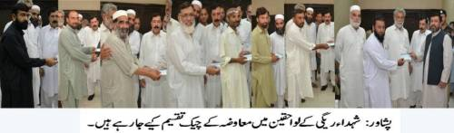 DHA Peshawar cheque distribution among land owners