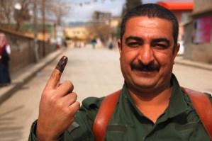 A Peshmerga guide has voted (2010)c