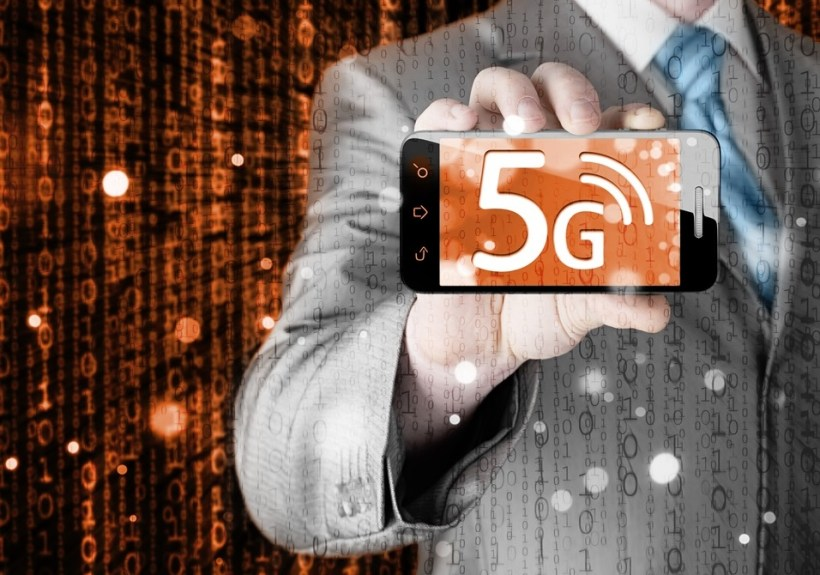businessman holding in hand 5G