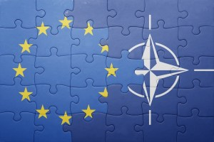 puzzle with the national flag of european union and nato . concept