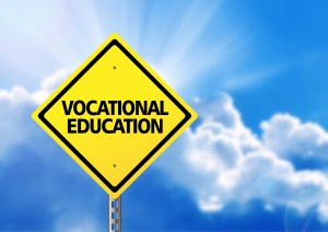 Yellow road sign with text vocational education.