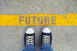 Male sneakers on the asphalt road with yellow line and title Future. Step into the future.