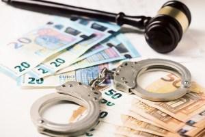 euro money and handcuff