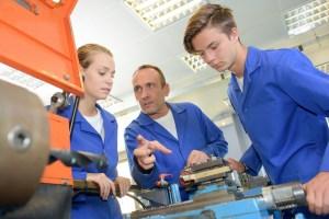 Supervisor instructing apprentices