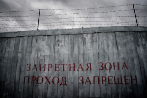 high fence with barbed wire