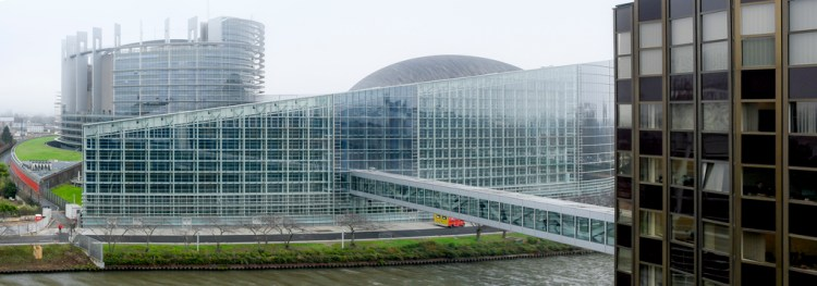 A foggy day in Strasbourg. Louise Weiss building and Winston churchill passerelle - Ill river