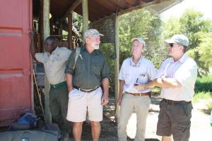 Mr Koos Verwey and SRT Trustees Dr Axel Hartmann and Rob Moffet. The SRT Trustees were seeing off one of the tracker teams on a rhino protection mission.