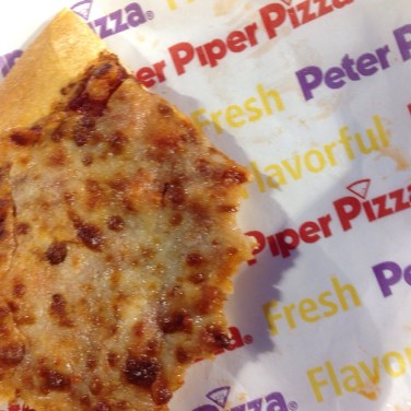 A half-eaten $6 slice of cheese pizza from Peter Piper