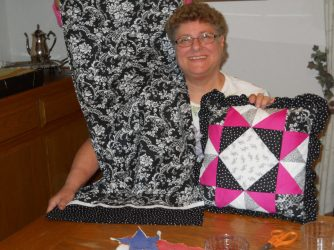 Dora Moore made this extra long pillowcase for a body pillow, and then the throw pillow for the top of the bed.
