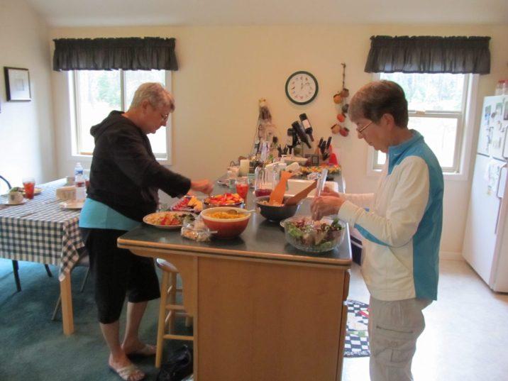 Maxine and Betty prepare food