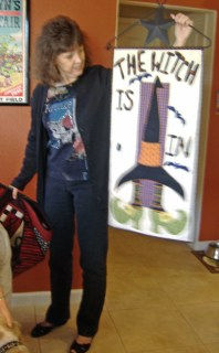 Terry Sheldon shows her Halloween-themed quilt.