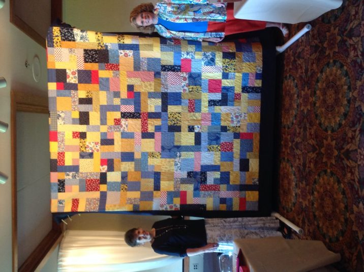 Raffle quilt with Piecemakers members Terry Sheldon and Elaine Slate
