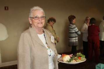 Marcia Liekkio, shows off a deliciuos plate of food at the end of the buffet line.