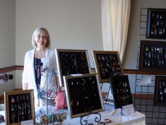 Carolyn Hein with her display of wonderful and varied jewelry.