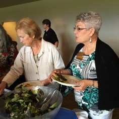 President Annette Godfrey and past-president Maxine Williams enjoying the buffet line.