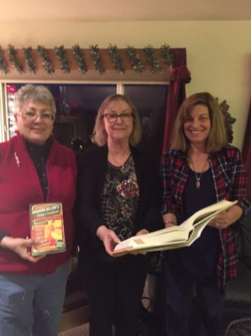 Maxine Williams, Virginia Felker and Sue Tschohl checking out some of the cookbooks selected for 2017.