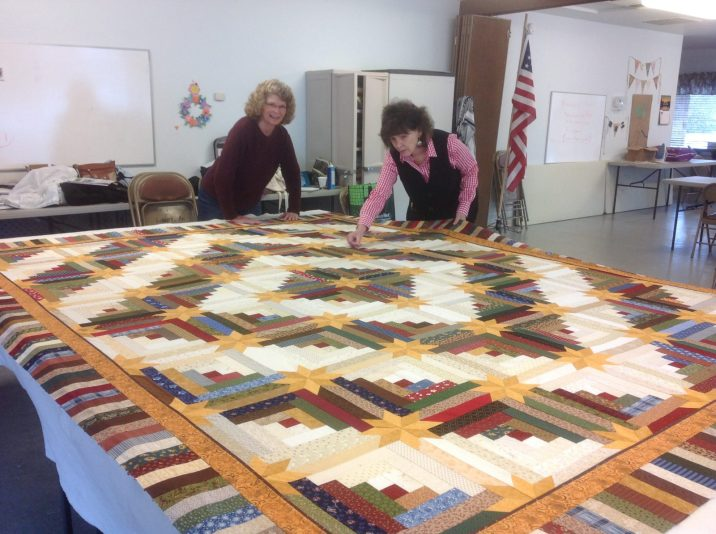 Basting the Star Log Cabin opportunity quilt.