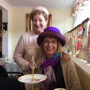 Ann Grossman and Martha Roy sporting some elegant hats