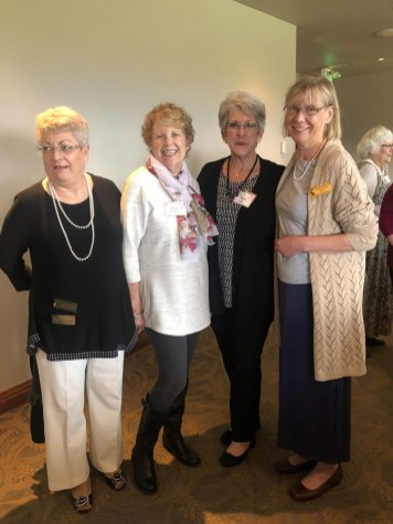 Joyce Todd, Maxine Williams, Martha Roy and a new member enjoy some social time in the food line